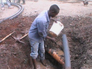 The Water Project : kenya-pamojamashimoni-34-clearing-of-the-drainage-for-water-connection-in-mashimoni-3