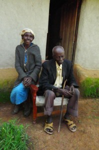 The Water Project : kenya4285-17-jorum-and-his-wife-mary-sitting-in-front-of-their-house-chatting-with-us