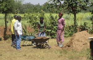 The Water Project : kenya4332-58-mayungu-community-members-helping-to-mobilize-materials
