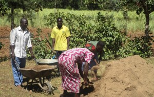 The Water Project:  Mayungu Community Members Helping To Mobilize Materials