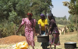 The Water Project:  Mayungu Women Collecting Water For Construction