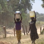 The Water Project: Mayungu Church Of God -  Mayungu Women Collecting Water For Construction