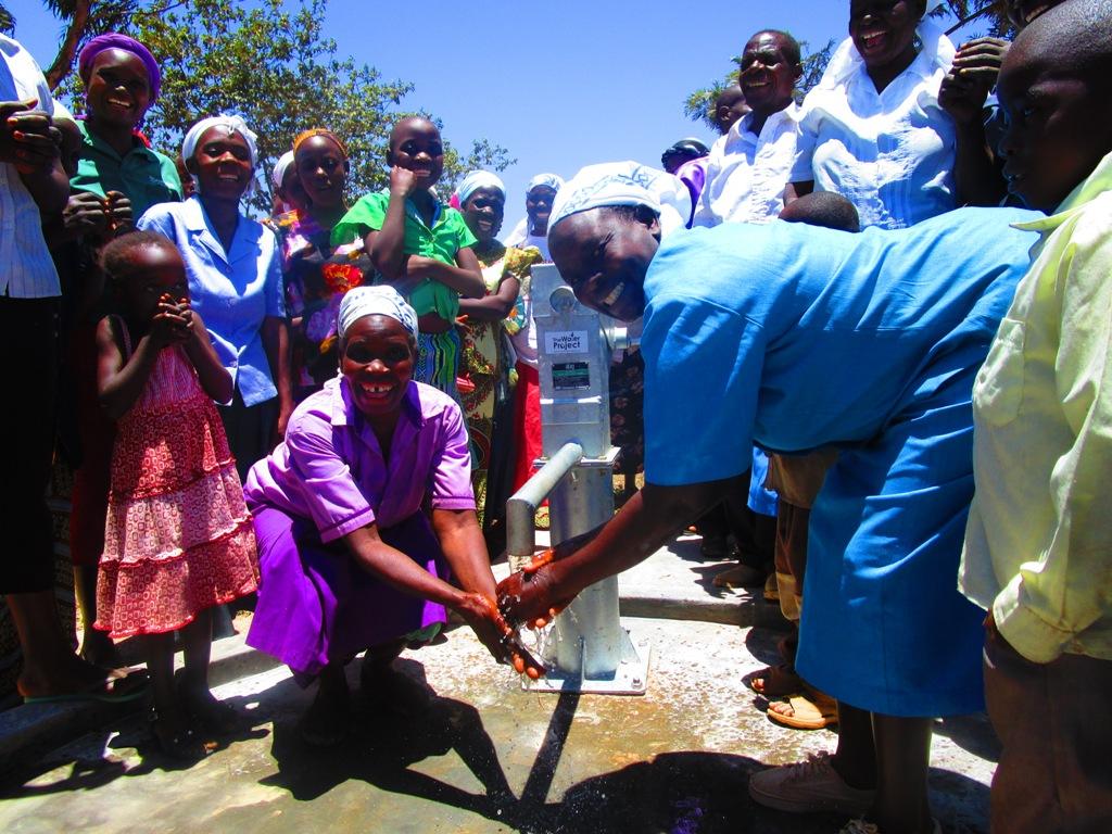 The Water Project : kenya4332-83-emayungu-church-of-god-handing-over
