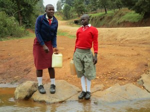 The Water Project:  Shisango Girls Fetching Water From Their Current Water Source