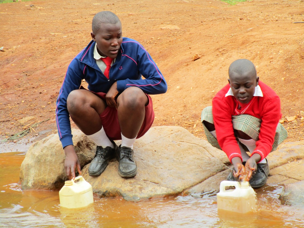 The Water Project : kenya4333-17-shisango-girls-fetching-water-from-their-current-water-source