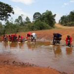 The Water Project: Shisango Secondary School -  Shisango Girls Fetching Water From Their Current Water Source