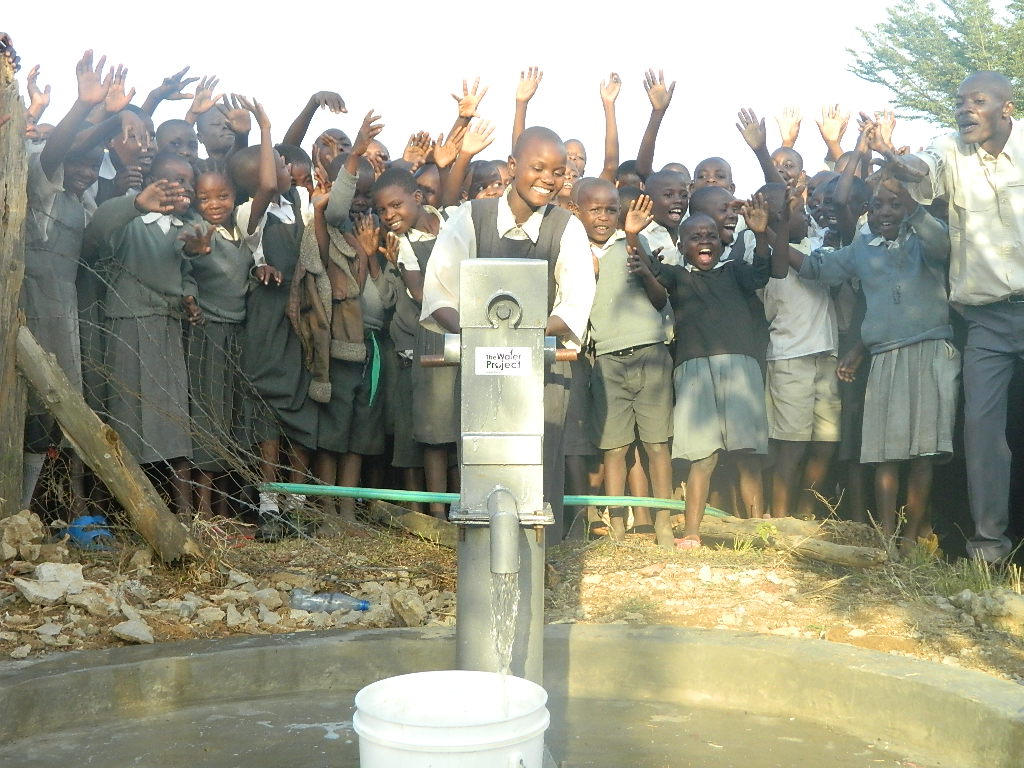The Water Project : kenya4337-60-tumaini-pupils-celebrating-the-flowing-of-water-in-their-school