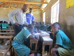 The Water Project : kenya4339-23-teachers-helping-the-pupils-on-discussion-question