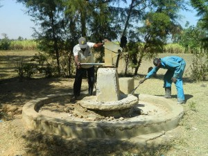 The Water Project : kenya4339-25-removing-the-broken-pump-post