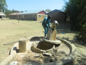 The Water Project : kenya4339-26-removing-the-broken-pump-post