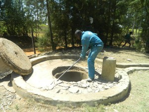 The Water Project : kenya4339-27-hackin-off-the-well-pad