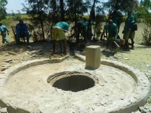 The Water Project : kenya4339-28-pupils-helping-in-cleaning-around-the-well-pad