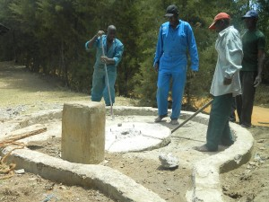 The Water Project : kenya4339-29-putting-back-the-slab
