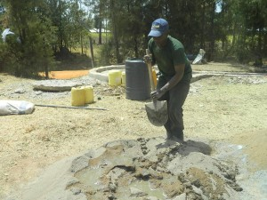 The Water Project : kenya4339-30-sand-cement-and-water-mixing