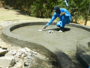 The Water Project : kenya4339-36-plastering-of-the-well