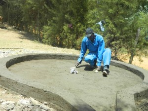 The Water Project : kenya4339-37-plastering-of-the-well