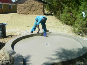 The Water Project : kenya4339-38-finishing-the-plastering