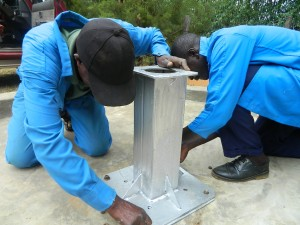 The Water Project : kenya4339-42-tightening-the-stand-bolts