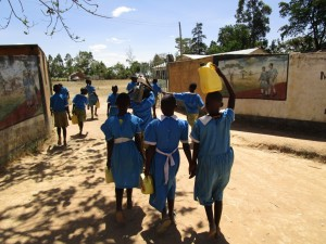 The Water Project : kenya4344-09-pupils-from-the-current-water-source