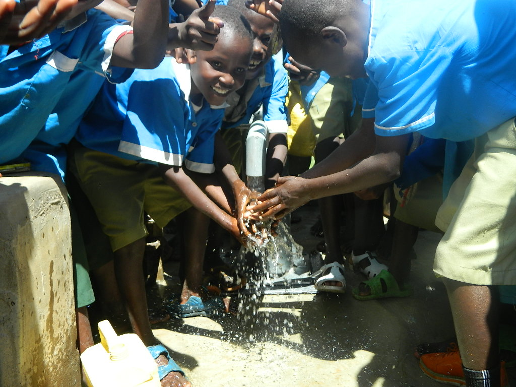 The Water Project : pupils-are-happy-enjoying-the-clean-and-safe-water-5-2