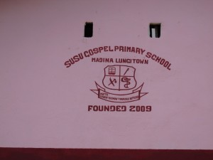 The Water Project : sierraleone5070-21-school-name-on-side-of-building