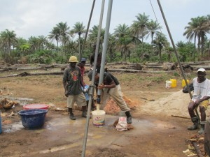 The Water Project : sierraleone5070-33-manual-yield-testing-emptying-yield-testing-pipe