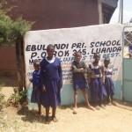 The Water Project: Ebulondi Primary School Rainwater Harvesting and VIP Latrines -  School Gate