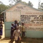 The Water Project: Ebulondi Primary School Rainwater Harvesting and VIP Latrines -  Students Arriving