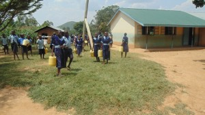 The Water Project : kenya4326-91-pupils-of-eshinutsa-primary-school-asked-to-bring-water-nearby-unprotected-spring-which-is-1-6-kilometers-away