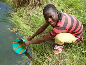 The Water Project : sierra-leone5066-04-alt-water-source-fetch-water