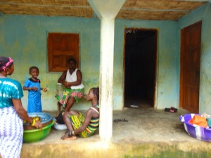 The Water Project : sierra-leone5072-03-house-and-community-members