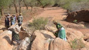The Water Project : women-breaking-rocks-for-construction-kwa-mutunga-gabion-project-shg-19