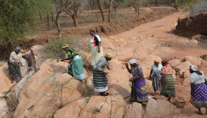 The Water Project : women-breaking-rocks-for-construction-kwa-mutunga-gabion-project-shg-2
