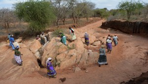 The Water Project : women-breaking-rocks-for-construction-kwa-mutunga-gabion-project-shg-3