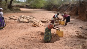 The Water Project : collecting-water-for-construction-kwa-mutunga-gabion-project-shg-8