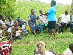 The Water Project : kenya4338b-72-community-meber-explaining-the-good-and-bad-picture