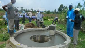 The Water Project : kenya4338b-73-final-plastering-of-the-well-pad