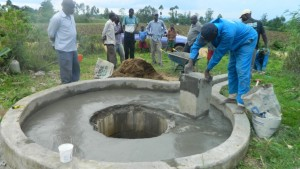 The Water Project : kenya4338b-74-smooth-plastering-being-done-to-the-well