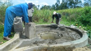 The Water Project : kenya4338b-78-cementing-the-well-pad