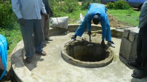 The Water Project : kenya4338b-80-removal-of-broken-cement