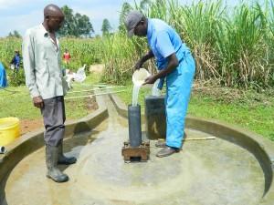 The Water Project : kenya4338b-82-chlorinating-mutsuma-community-borehole