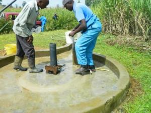 The Water Project : kenya4338b-83-chlorinating-mutsuma-community-borehole