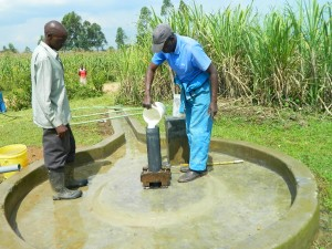The Water Project : kenya4338b-85-chlorinating-mutsuma-community-borehole
