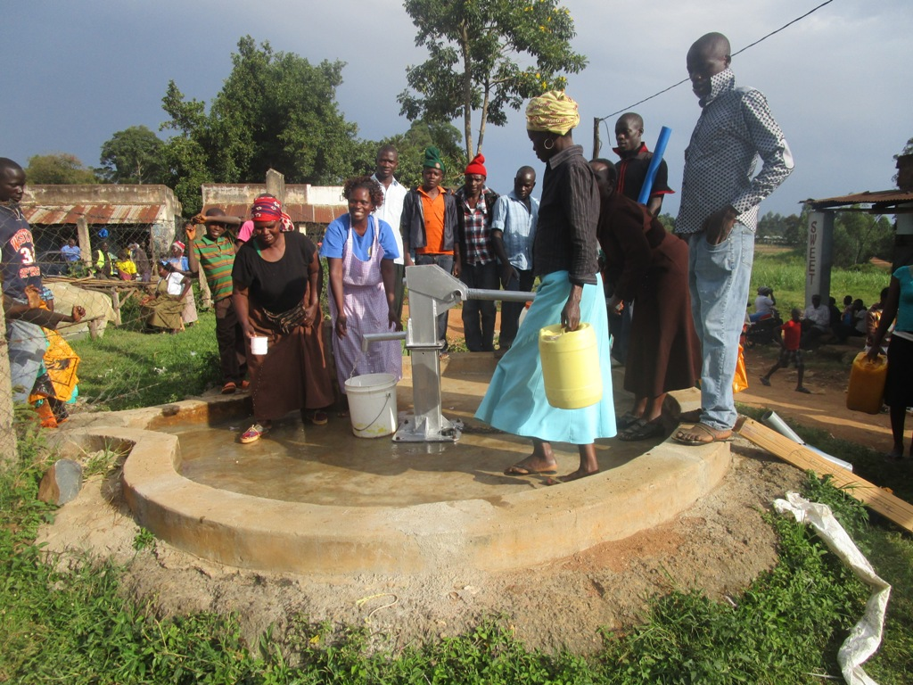The Water Project : kenya4353-62-market-users-enjoying-the-new-source-at-butali