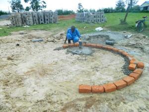 The Water Project : kenya4365-34-samitsi-girls-pad-construction