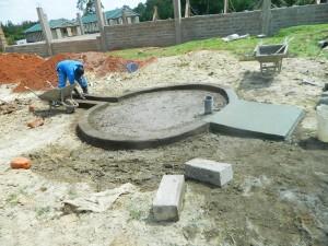 The Water Project : kenya4365-39-samitsi-girls-pad-construction