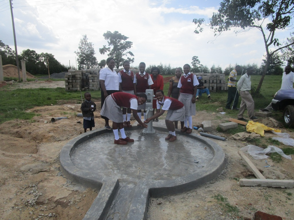 The Water Project : kenya4365-49-samitsi-girls-water-flowing