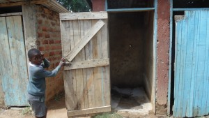 The Water Project : kenya4404-18-a-boy-poses-for-a-photo-in-front-of-vip-latrine