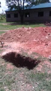 The Water Project : kenya4404-29-latrine-construction