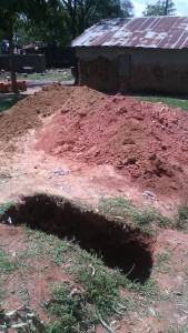 The Water Project : kenya4404-31-latrine-construction